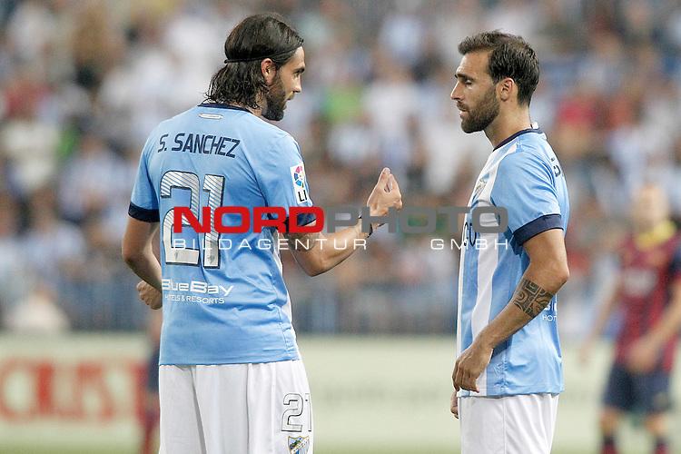 Malaga's Sergio Sanchez (l) and Jesus Gamez during La Liga match.August 25,2013. Foto © nph / Acero)