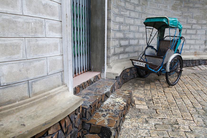 A blue rickshaw abandoned by Nah Trang Cathedral.