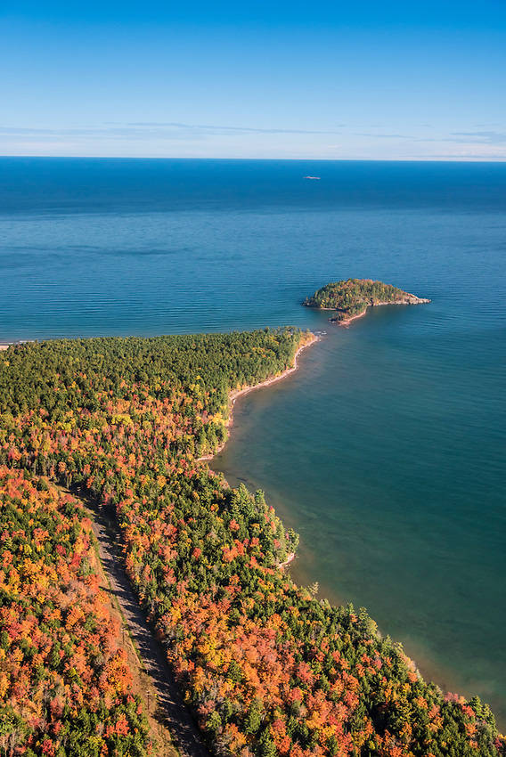 Aerial photography of the rugged Lake Superior shoreline north of Marquette, Michigan during fall color season. Areas shown include County Road 550 and Little Presque Isle.
