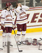Meghan Grieves (BC - 17), Emily Field (BC - 15) -  The Boston College Eagles defeated the visiting Boston University Terriers 5-0 on BC's senior night on Thursday, February 19, 2015, at Kelley Rink in Conte Forum in Chestnut Hill, Massachusetts.