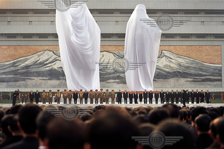 Two new statues of Eternal President Kim Il-sung (left) and Supreme Leader Kim Jong-il (right), on Mansu Hill, wait to be unveiled by of Kim Jong-un, the new leader of PRNK.
