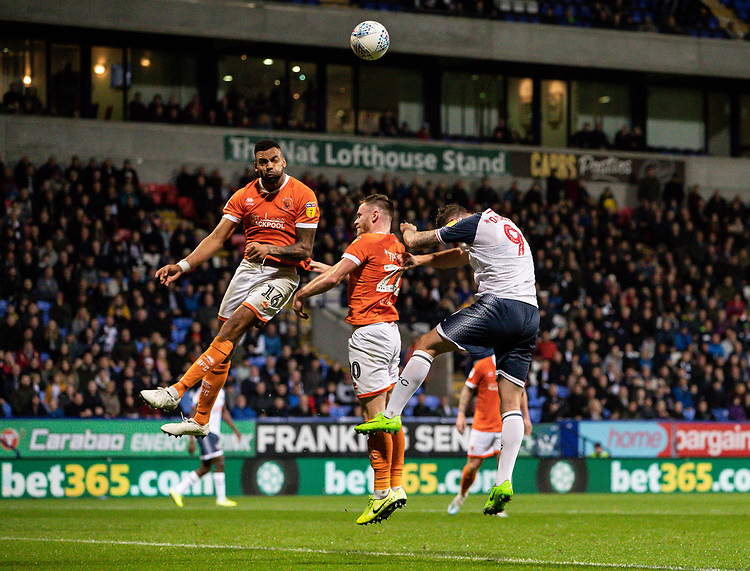 Bolton Wanderers' Daryl Murphy (right) competing with Blackpool's Curtis Tilt (left) and Oliver Turton <br /> <br /> Photographer Andrew Kearns/CameraSport<br /> <br /> The EFL Sky Bet League One - Bolton Wanderers v Blackpool - Monday 7th October 2019 - University of Bolton Stadium - Bolton<br /> <br /> World Copyright © 2019 CameraSport. All rights reserved. 43 Linden Ave. Countesthorpe. Leicester. England. LE8 5PG - Tel: +44 (0) 116 277 4147 - admin@camerasport.com - www.camerasport.com