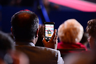 National Harbor, MD - February 23, 2018: A man video records President Donald Trump as he speaks at the Conservative Political Action Conference (CPAC) at the Gaylord National Hotel in National Harbor, MD, February 23, 2018. (Photo by Don Baxter/Media Images International)