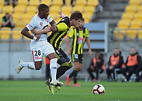 Alex Rufer tries to hold off Roly Bonevacia during the A-League football match between Wellington Phoenix and West Sydney Wanderers at Westpac Stadium in Wellington, New Zealand on Sunday, 17 March 2019. Photo: Dave Lintott / lintottphoto.co.nz