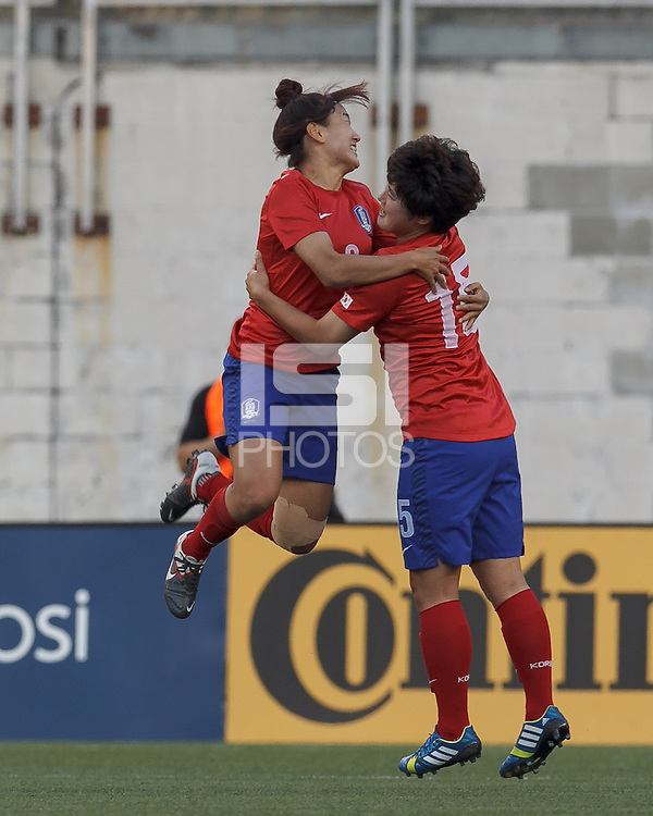 Korea Republic midfielder Cho Sohyun (8) celebrates her goal with teammates.  In an international friendly, the U.S. Women's National Team (USWNT) (white/blue) defeated Korea Republic (South Korea) (red/blue), 4-1, at Gillette Stadium on June 15, 2013.