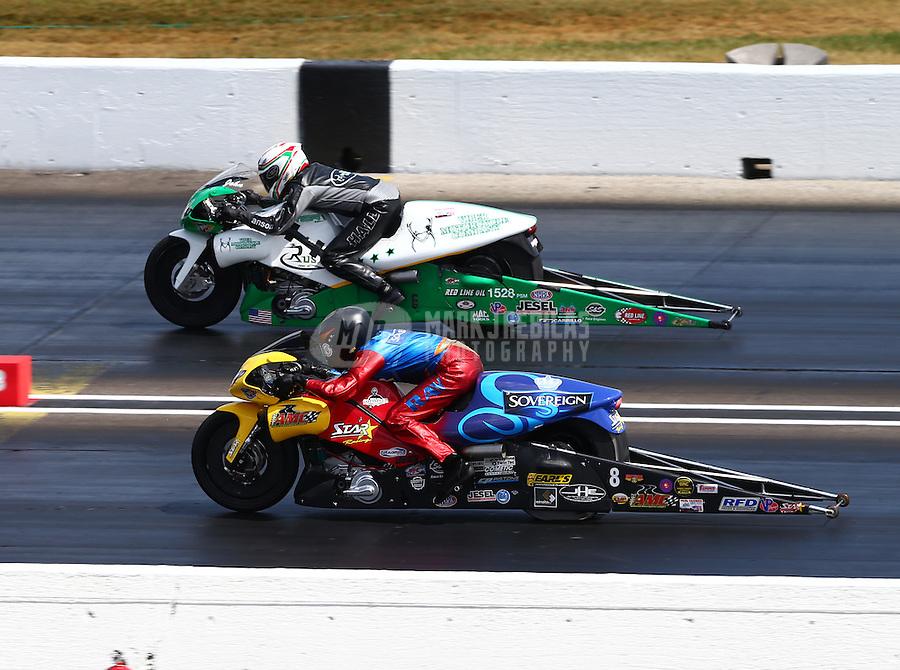 Sept. 2, 2013; Clermont, IN, USA: NHRA pro stock motorcycle rider John Hall (far lane) races alongside Michael Ray Jr during the US Nationals at Lucas Oil Raceway. Mandatory Credit: Mark J. Rebilas-
