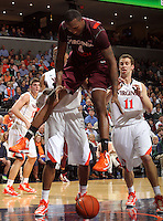 Virginia Tech forward Cadarian Raines (4) looses control of the ball during the game Tuesday in Charlottesville, VA. Virginia defeated Virginia Tech73-55.