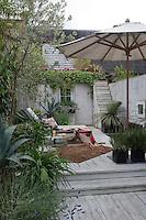 The garden is a haven in the centre of London, designed by Ben de Lisi's partner Gerardo Vidaurre