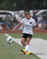 Portland Thorns FC midfielder Tobin Heath (17) passes the ball.  In a National Women's Soccer League (NWSL) match, Portland Thorns FC (white/black) defeated Boston Breakers (blue), 2-1, at Dilboy Stadium on July 21, 2013.