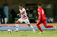 GEORGETOWN, GRAND CAYMAN, CAYMAN ISLANDS - NOVEMBER 19: Reggie Cannon #20 of the United States turns and moves with the ball during a game between Cuba and USMNT at Truman Bodden Sports Complex on November 19, 2019 in Georgetown, Grand Cayman.