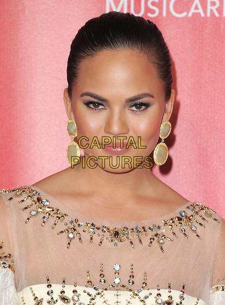 Chrissy Teigen.The MusiCares 2013 Person Of The Year Tribute held at The Los Angeles Convention Center, West Hall in Los Angeles, California, USA..February 8th, 2013.headshot portrait white sheer beaded dangling earrings .CAP/RKE/DVS.©DVS/RockinExposures/Capital Pictures.