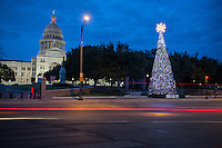 The Texas State Capitol building with Christmas tree in the foreground in downtown Austin, Texas.