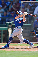 Enrique Hernandez (14) of the Los Angeles Dodgers follows through on a swing during a Cactus League Spring Training game against the Texas Rangers on March 8, 2020 at Surprise Stadium in Surprise, Arizona. Rangers defeated the Dodgers 9-8. (Tracy Proffitt/Four Seam Images)