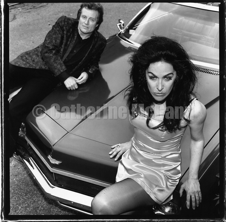 """1994:  Portrait of Diamanda Galas and John Paul Jones, sitting on a car  in Jersey City, New Jersey,  shot for the release of their album """"The Sporting Life""""..Copyright 2010 Catherine McGann/ All RIghts Reserved"""