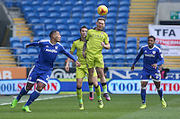 Jon Taylor of Rotherham United beats Kenneth Zohore of Cardiff City to the aerial ball during the Sky Bet Championship match between Cardiff City and Rotherham United at the Cardiff City Stadium, Wales, UK. 18 February 2017