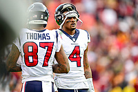 Landover, MD - November 18, 2018: Houston Texans quarterback Deshaun Watson (4) and Houston Texans wide receiver Demaryius Thomas (87) on the sideline during second half action of game between the Houston Texans and the Washington Redskins at FedEx Field in Landover, MD. The Texans defeated the Redskins 23-21. (Photo by Phillip Peters/Media Images International)