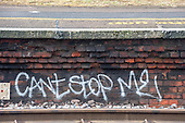 "Norbiton station, Surrey. Graffitti ""Can't stop me"" under the platform."