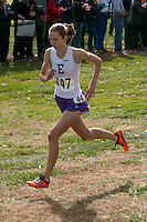 Eureka's Hannah Long has only her shadow to contend with when she nears the finish and a dominating victory in the Class 4 race at the 2014 MSHSAA State Cross Country Championship in Jefferson City, MO. Saturday, November 8.