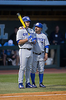 Kole Cottam (left) gets instructions from third base coach Roland Fanning (0) during the top of the 9th inning against the North Carolina Tar Heels at Boshmer Stadium on February 17, 2017 in Chapel Hill, North Carolina.  The Tar Heels defeated the Wildcats 3-1.  (Brian Westerholt/Four Seam Images)