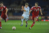 It's a race to get to the ball first between Riku Riski of Finland and Sam Ricketts of Wales during the Wales v Finland Vauxhall International friendly football match at the Cardiff City stadium, Cardiff, Wales. Photographer - Jeff Thomas Photography. Mob 07837 386244. All use of pictures are chargeable.