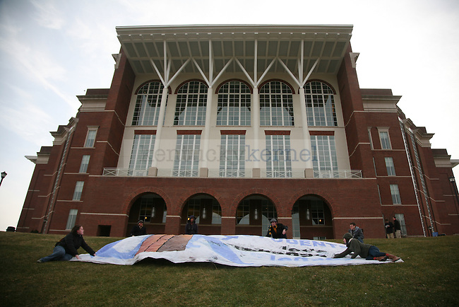 Members of UK's greenthumb club lay down a 40 foot banner on the bowl of William T. Young Library at 10:45 a.m. on the Rose St. side entrance. The group protested coal and kept the sign on the grass for 15 minutes. Photo by Brandon Goodwin | Staff