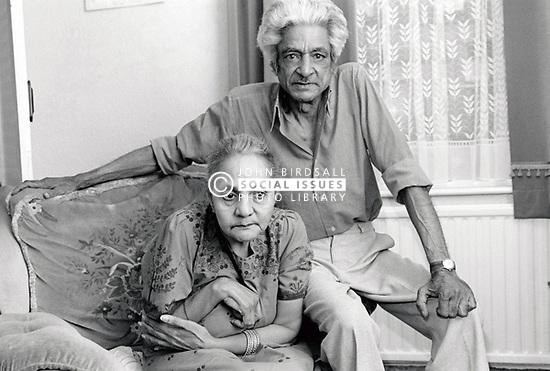 Elderly Asian man caring for his wife, Nottingham UK 1991