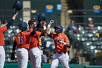 Branden Comia (23) of the Illinois Fighting Illini is congratulated by his teammates after hitting a two-run home run against the West Virginia Mountaineers at TicketReturn.com Field at Pelicans Ballpark on February 23, 2020 in Myrtle Beach, South Carolina. The Fighting Illini defeated the Mountaineers 2-1.  (Brian Westerholt/Four Seam Images)