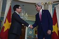 Washington, DC - March 30, 2016: U.S. Secretary of State John Kerry shakes hands with Vietnamese Deputy Prime Minister and Foreign Minister Pham Binh Minh in the Treaty Room at the Department of State in the District of Columbia, March 30, 2016, one day ahead of the Nuclear Summit at the Washington Convention Center (Photo by Don Baxter/Media Images International)
