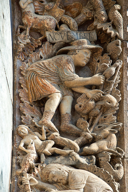13th century Medieval Romanesque Sculptures from the introdos of the second arch of the facade of St Mark's Basilica, Venice, depicting November from the Months of the Zodiac .