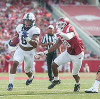 NWA Democrat-Gazette/J.T. WAMPLER Arkansas' Randy Ramsey tries to catch TCU's Darius Anderson Saturday Sept. 9, 2017 at Donald W. Reynolds Razorback Stadium in Fayetteville. Arkansas lost 28-7.