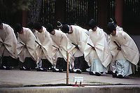 Priests bow in a line outside Sanjusangen-do Temple in Kyoto, Japan. This temple dates from the 12th century and is still the longest wooden structure in the world. Its name derives from the 33 (sanjusan) spaces between its pillars.