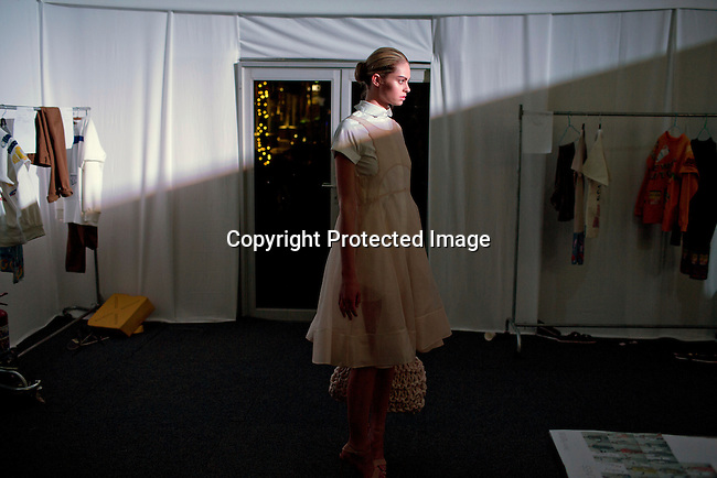 JOHANNESBURG, SOUTH AFRICA OCTOBER 29: A model walking for the Elle rising star designer label MRP waits backstage before a show at Mercedes Benz Africa fashion week Africa on October 29, 2014 held at Melrose Arch in Johannesburg, South Africa. Designers from all over Africa showed their best collections at the yearly event. (Photo by: Per-Anders Pettersson)