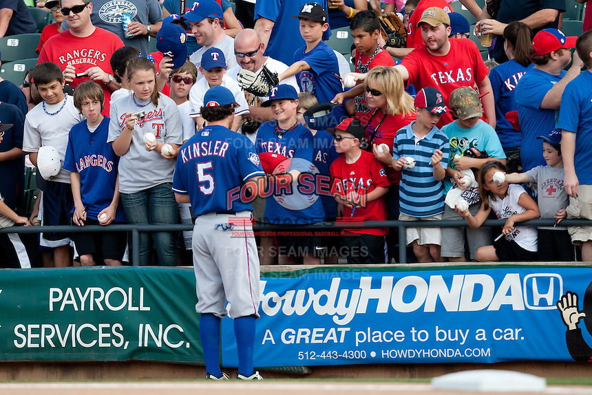 """Texas Rangers second baseman Ian Kinsler #5 signs autographs before the MLB exhibition baseball game against the """"AAA"""" Round Rock Express on April 2, 2012 at the Dell Diamond in Round Rock, Texas. The Rangers out-slugged the Express 10-8. (Andrew Woolley / Four Seam Images)."""