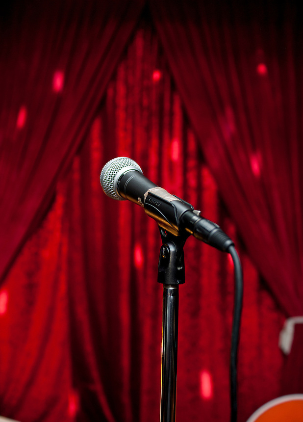 Red velvet curtains and microphone. Stand up comedy in cafe 22, Colonia Condesa, Mexico DF