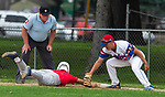 WINSTED , CT-080720JS13—Winsted's Kyle Matthews (29) dives back to first base ahead of the tag by Waterford's Dan Driscoll (10) during their CTEBA U19 playoff game Friday at Walker Field in Winsted. <br /> Jim Shannon Republican-American