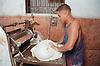 Baker kneading dough to make bread in bakery in Havana; Cuba,