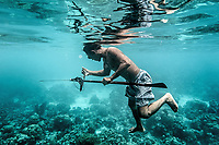 Dafrin Ambotang, 35, clutches onto a fish he has just speared near Malenge Island, Indonesia. Ambotang is one of just a handful of men in his village to have retained the free-diving skills of the previous generation. (Photo: Aurélie Marrier d'Unienville)