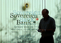 Sovereign Bank customer walks past the branch Tuesday, Oct. 10, 2006 in downtown Reading,Pa. . A majority of the bank's directors called for the special meeting today to consider chairman and chief executive officer Jay S. Sidhu's departure after big institutional investors, including the California and Pennsylvania state workers' and state teachers' pension funds, withheld votes for three veteran directors tied to Sidhu in elections last month. Bradley C Bower/Bloomberg News
