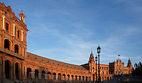 General view of Plaza de Espana, Seville, Spain, pictured on December 25, 2006, in the late afternoon. Built in the Maria Luisa Park for the  Ibero-American Exposition of 1929, this huge semi-circular building, designed by Anibal Gonzalez, is a good example of Sevillian Regionalism, a combination of  Neo-Mudejar and Art Deco styles. There is a tower at each end, and a fountain in the centre of the semi-circle. Picture by Manuel Cohen.