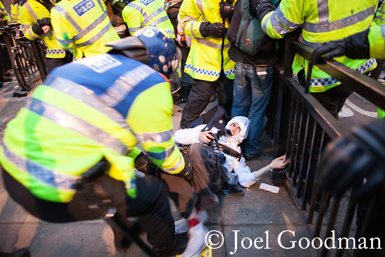 "© Joel Goodman - 07973 332324 . 26/03/2011 . London , UK . Police detain UK Uncut protesters who have occupied Fortnum and Mason in Piccadilly . Hundreds of thousands of people attend an anti cuts demonstration under the banner "" March for the Alternative "" in central London , in protest at the coalition government's austerity measures . Photo credit : Joel Goodman"