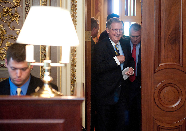 UNITED STATES - JULY 26: Senate Minority Leader Mitch McConnell, R-Ky, followed by Sen. Jon Kyl, R-Ariz., leave the Senate Repubicans' policy lunch on Tuesday, July 26, 2011. (Photo By Bill Clark/Roll Call)