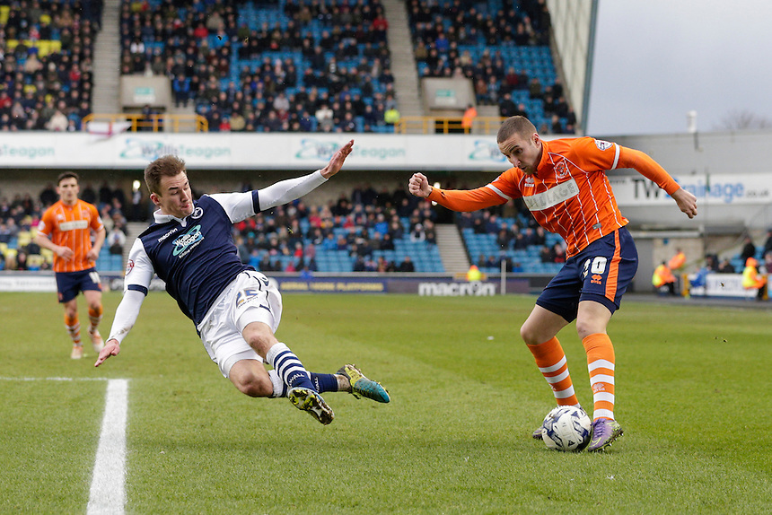 Blackpool's Martin Paterson gets a cross in despite the attentions of Millwall's Jed Wallace<br /> <br /> Photographer Craig Mercer/CameraSport<br /> <br /> Football - The Football League Sky Bet League One - Millwall v Blackpool - Saturday 5th March 2016 - The Den - Millwall<br /> <br /> &copy; CameraSport - 43 Linden Ave. Countesthorpe. Leicester. England. LE8 5PG - Tel: +44 (0) 116 277 4147 - admin@camerasport.com - www.camerasport.com