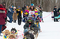 Monica Zappa and team run past spectators on the bike/ski trail near University Lake with an Iditarider in the basket and a handler during the Anchorage, Alaska ceremonial start on Saturday, March 7 during the 2020 Iditarod race. Photo © 2020 by Ed Bennett/Bennett Images LLC