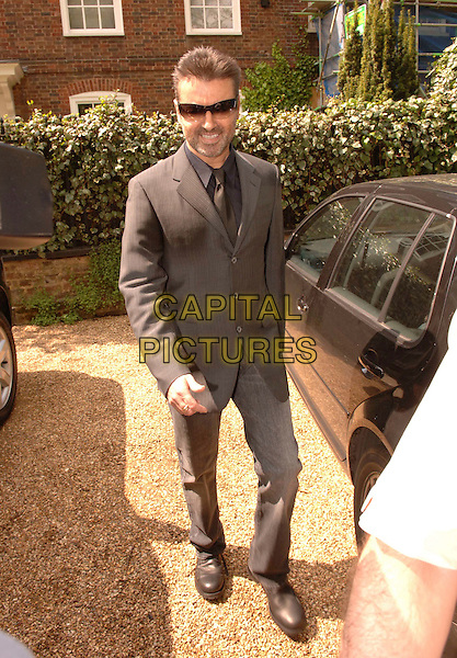 GEORGE MICHAEL.Leaving his London home, London, England, May 7th 2006..full length suit sunglasses.Ref: FIN.www.capitalpictures.com.sales@capitalpictures.com.©Steve Finn/Capital Pictures.