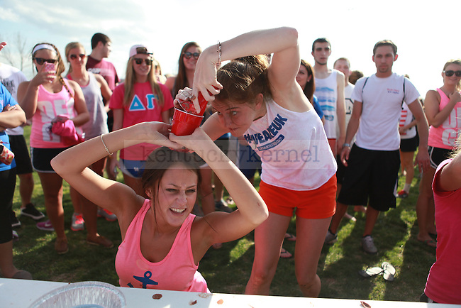 Erika Couch and Lindsay Postlewaite participate in a contest at the PiAthalon, a charity event hosted by the sorority Alpha Omicron Pi, Iota Phi Theta fraternity and Farmhouse fraternity on April 10, 2012, in Lexington, Ky. Photo by Emily Wuetcher | Staff....