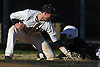 Jimmy Joyce #3 of Wantagh, left, tries to tag Andrew Genovese #37 of Hewlett as he slides safely into third base in the top of the fourth inning of a Nassau County varsity baseball game at Wantagh High School on Tuesday, Apr. 5, 2016. Wantagh won by a score of 9-4.