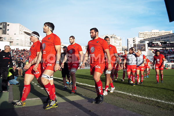 The Toulon team head back to the changing rooms at the end of the pre-match warm-up. European Rugby Champions Cup match, between RC Toulon and Bath Rugby on January 10, 2016 at the Stade Mayol in Toulon, France. Photo by: Patrick Khachfe / Onside Images