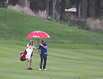 Parraig Harrington hands an umbrella to his caddy during the Barracuda Championship PGA golf tournament at Montrêux Golf and Country Club in Reno, Nevada on Friday, July 26, 2019.