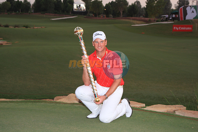 Robert Karlson holding his trophy for winning the Dubai world Championship during the final round of the Dubai World Championship on the Earth Course at the Jumeirah Golf Estate, Dubai..Picture Fran Caffrey/www.golffile.ie.