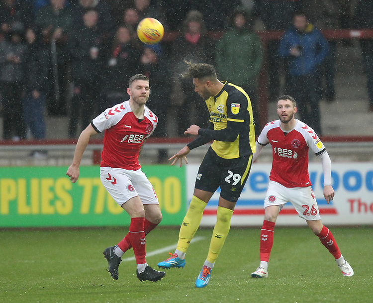 Fleetwood Town's James Husband in action with Scunthorpe Utd's Kyle Wootton<br /> <br /> Photographer Mick Walker/CameraSport<br /> <br /> The EFL Sky Bet League One - Fleetwood Town v Scunthorpe United - Saturday 26th January 2019 - Highbury Stadium - Fleetwood<br /> <br /> World Copyright © 2019 CameraSport. All rights reserved. 43 Linden Ave. Countesthorpe. Leicester. England. LE8 5PG - Tel: +44 (0) 116 277 4147 - admin@camerasport.com - www.camerasport.com
